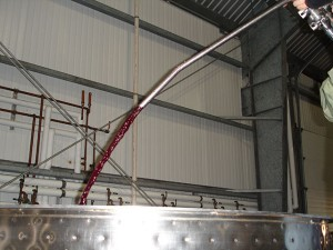 Pumping over pinot in open top fermenter.